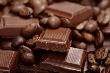 liveliness: Chocolate-Coffee background: Close-up of a beans, cup, mill