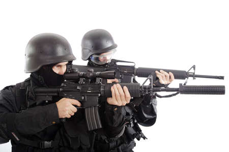 firearm: Shot of two soldiers holding guns. Stock Photo