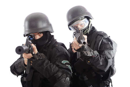 swat: Shot of two soldiers holding guns. Stock Photo
