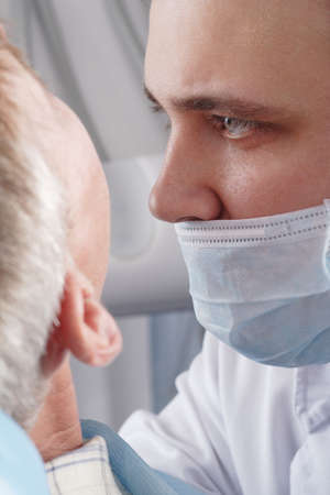 Dental background: work in clinic (operation, tooth replacement) photo