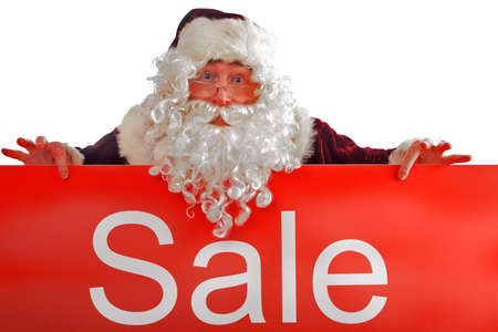 Santa holding onto a board with the word Sale photo