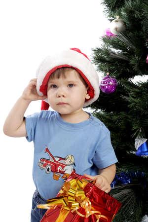 Xmas  background: Santa, gifts, kid. Stock Photo - 2139330