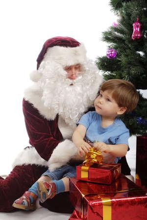 Xmas  background: Santa, gifts, kid. Stock Photo - 2204471