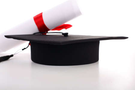 trade secret: Graduation cap and diploma isolated on white Stock Photo