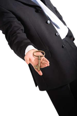 Golden key on the hand Stock Photo - 2204487