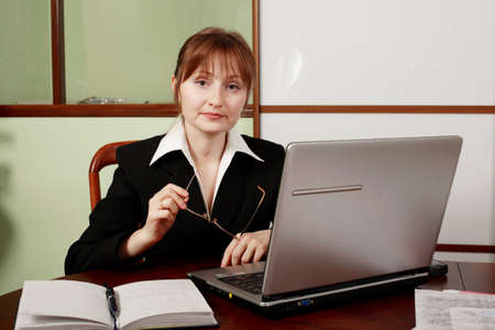 controling: Portrait of a businesswoman when working. Shot in studio.