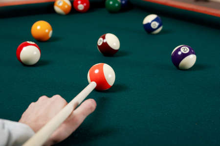 cue sticks: Billiard game details: balls, cue, table.