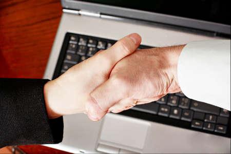 A handshake of seus peoples. Shot in studio. Stock Photo - 2354007
