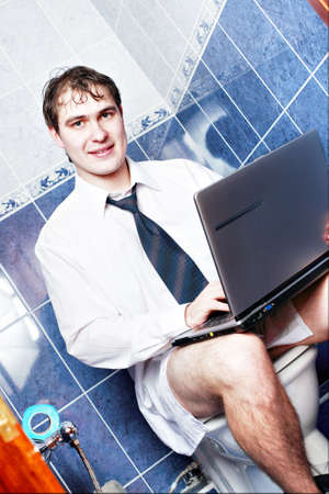 defecate: Young stylish man home with laptop Stock Photo