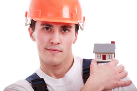 Muscular young man in a builder uniform with tools. Stock Photo - 2353962