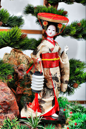 maiko: Japanese geisha doll on the white  background Stock Photo