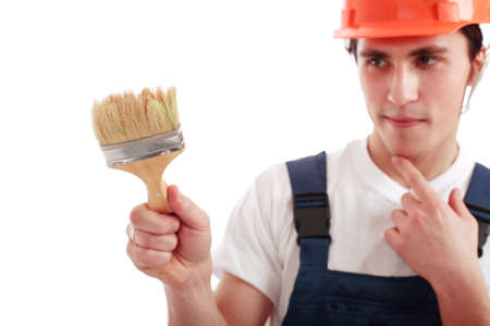 Muscular young man in a builder uniform with tools. Stock Photo - 2353954