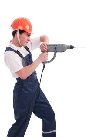 home repairs: Muscular young man in a builder uniform with tools.