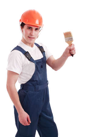 Muscular young man in a builder uniform with tools. Stock Photo - 2495871