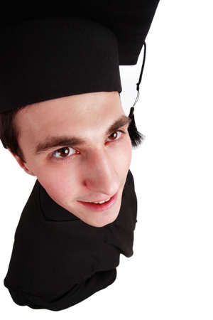 Portrait of a young man in an academic gown. Education background. photo