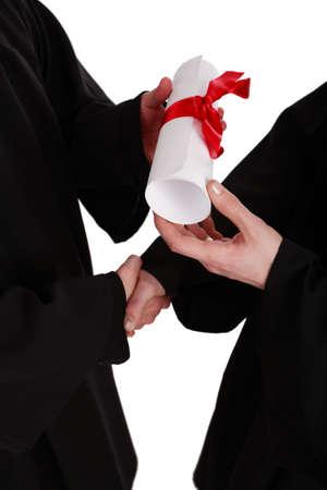 academic robe: A handshake, presentation with diploma. Graduation. Education background.