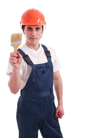 Muscular young man in a builder uniform with tools. Stock Photo - 2589824