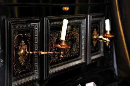 decrepitude: Style art background. Vintage books and candles.