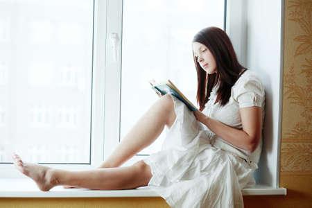Beautiful girl in a interior: education, fashion. Stock Photo