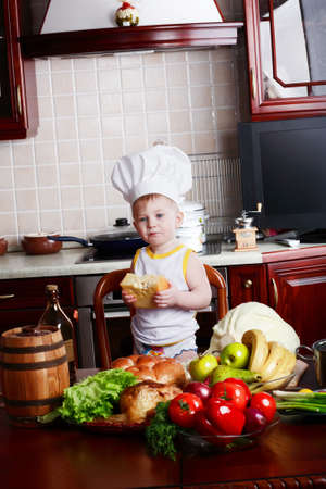 Little cook: fruits and  food photo