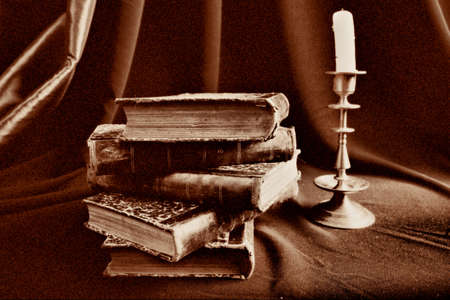 dilapidation: Style art background. Vintage things: books, candles and other.