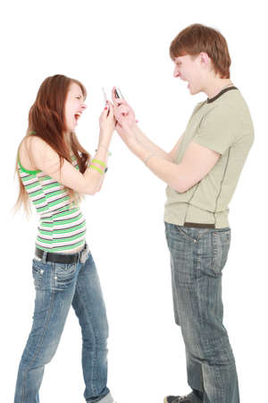 Two studentss with cellphones over white photo