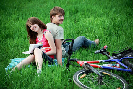 Beautiful couple lying on the grass photo