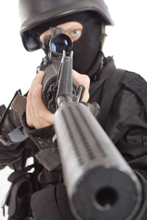 Shot of a soldier holding gun. Uniform conforms to special services. Stock Photo - 3278444