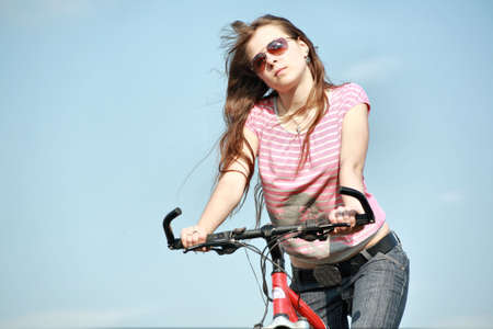 Beautiful girl cycling in the meadow Stock Photo - 3278500