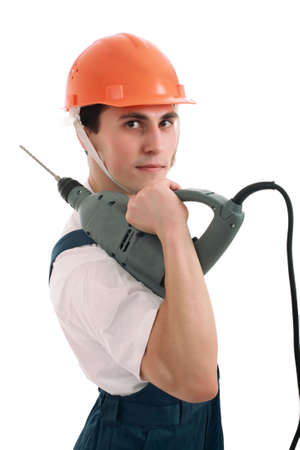 Muscular young man in a builder uniform with tools. photo