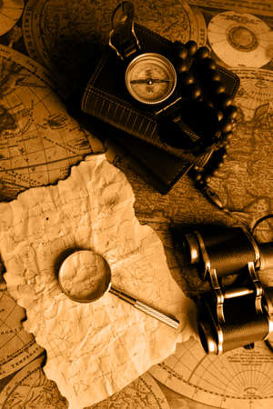 Old fashioned objects on the vintage map Stock Photo - 3309820