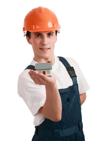 Muscular young man in a builder uniform with  model. photo