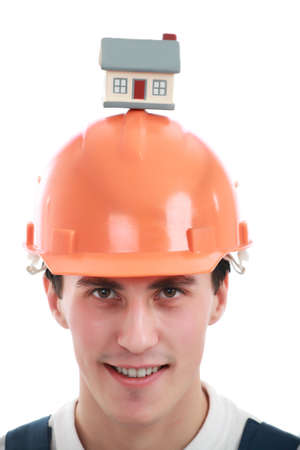 Muscular young man in a builder uniform with  model. Stock Photo - 3309764