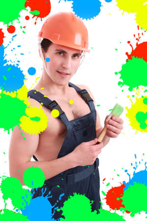 Muscular young man in a builder uniform with tools. Stock Photo - 3309786