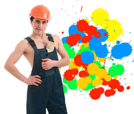 Muscular young man in a builder uniform with tools. Stock Photo - 3440086