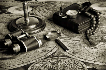 binoculars: Old fashioned objects on the vintage map Stock Photo