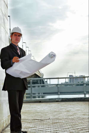 Business background: builder standing at building site. photo