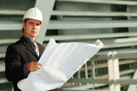 Business background: builder standing at building site. Stock Photo - 3436176