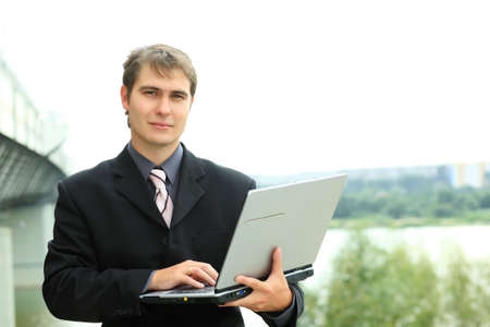 Business background: handsome businessman in a work process. Stock Photo - 3525985