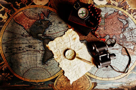 Old fashioned objects on the vintage map Stock Photo - 3582553