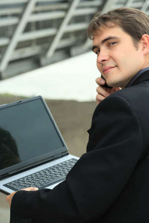 Business background: handsome businessman in a work process. Stock Photo - 3582420