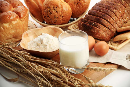 Baking ingredients, milk, and pastry isolated on white background photo