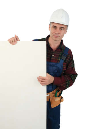 Muscular professional man in a builder uniform with tools. Stock Photo