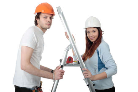 Young pair in a builder uniform with tools. photo