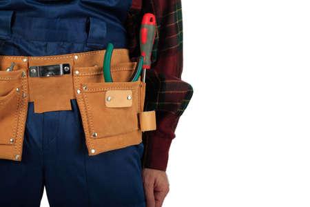 suede belt: Muscular profesional hombre en uniforme de un constructor de herramientas.