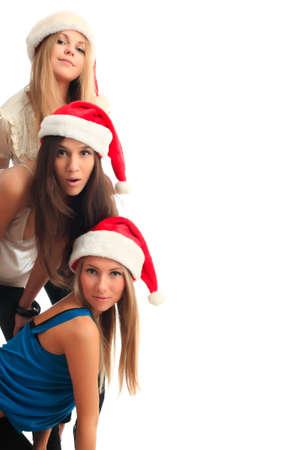 Xmas  background: girlfriends in santa cap Stock Photo - 3965845