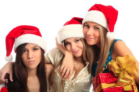 Xmas  background: girlfriends in santa cap Stock Photo - 3965893