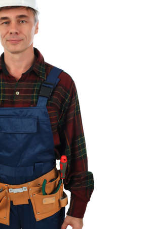 Muscular professional man in a builder uniform with tools. photo