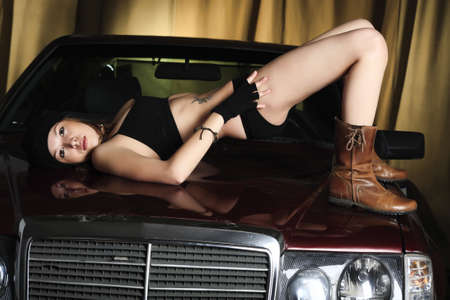 Portrait of a styled professional model in a car session. Stock Photo - 3996689
