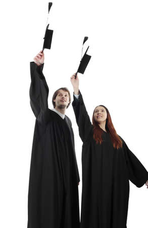 throw up: Portrait of a young peoplein a academic gown. Education background.